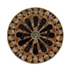 Tablero circular de mármol con incrustaciones de piedras semipreciosas.