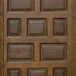 Puerta antigua de madera con cuarterones