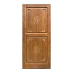 Puerta de interior de madera con talla a doble cara