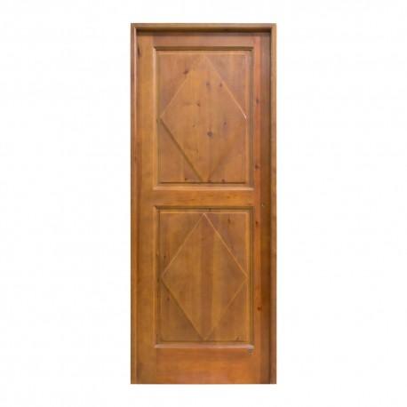 Puerta de interior de madera con cuarterones tallados