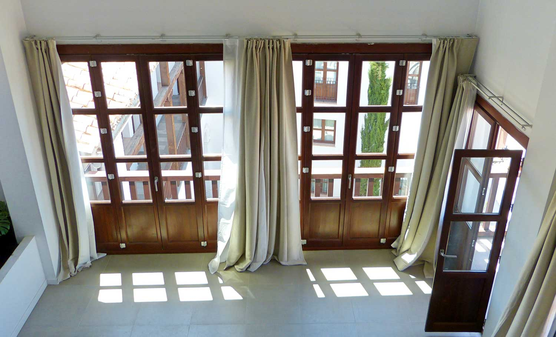 Ventana balcón madera a medida