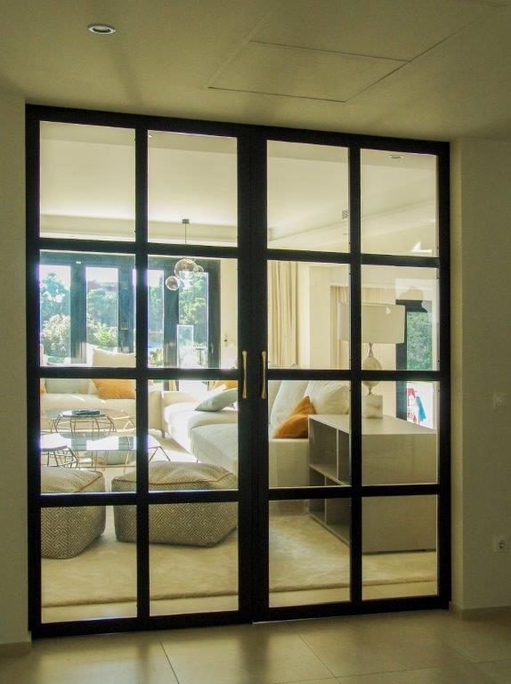 Puerta acristalada corredera de salón
